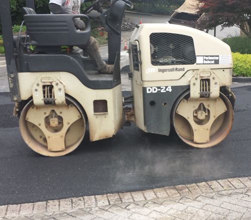 Compacting hot asphalt
