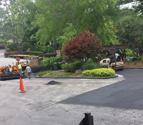 Asphalt company installing asphalt